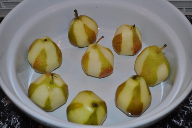 arrange peeled pears in a baking dish