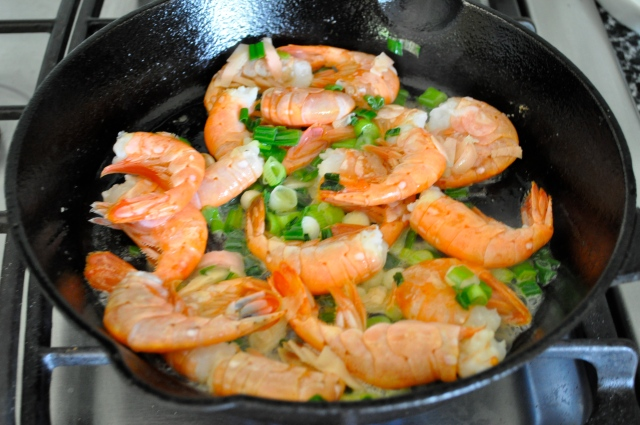 Saute the prawns til barely opaque, then add the ginger and gin