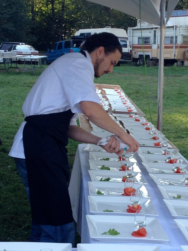 Chef Dan Hudson helping to plate the first course